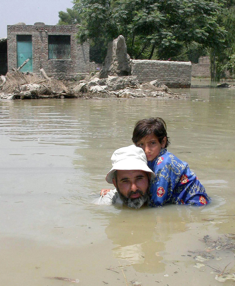 Disasters, like this flooding in Pakistan in 2005, can't be directly linked to climate change, but temperatures around the globe are climbing, says a U.N. weather panel.