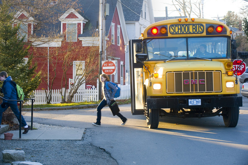 A school bus drops off students at the Waterman's Community Center after school.