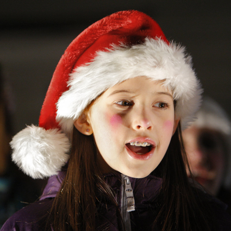 Calliope Landgrebe, 10, of Arundel sings a Christmas carol during Christmas Prelude in Kennebunkport on Friday. She and other children from the Academy of Developing Artists of Maine sang carols before the tree lighting ceremony in Dock Square.