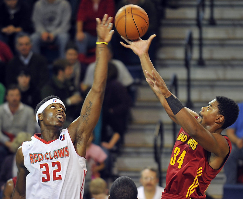 DeShawn Sims, left, of the Red Claws blocks a jump shot by Marvin Phillips of the Fort Wayne Mad Ants on Friday night at the Expo.