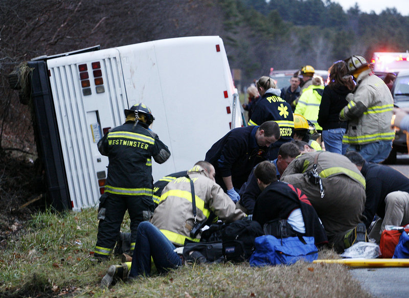 Emergency workers respond to a bus rollover on Friday in Putney, Vt. The bus was carrying a group of UMass students and others to a ski weekend in Quebec. Seventeen people were hurt, including the driver. It's unclear how the crash occurred, authorities said.