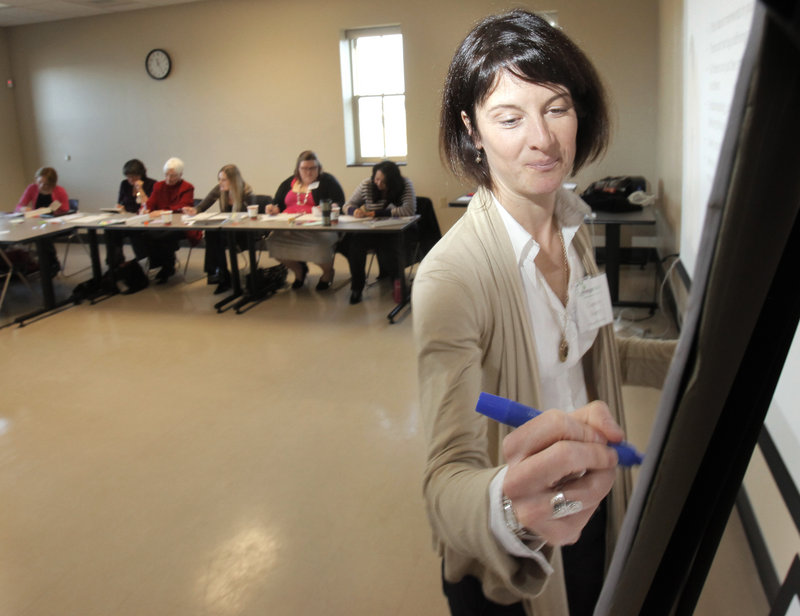 Facilitator Courtney Knapp jots down examples during a brainstorming session Saturday.
