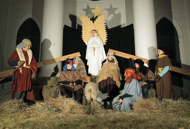 Children participate in a living Nativity tableau at the South Congregational Church in Kennebunkport on Friday. The scene was part of the town's 29th Christmas Prelude, which runs through next weekend.
