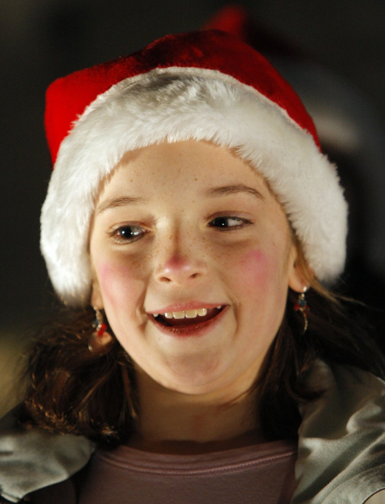 Samantha Creech, 10, sings a Christmas carol Friday night with a group from Academy of Developing Artists of Maine, based in Biddeford.