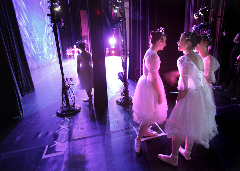 Girls who are dancing the role of Snowflakes wait their cue at Saturday afternoon's performance of
