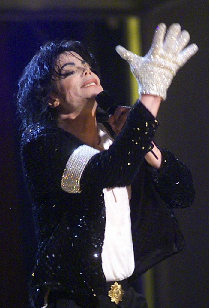 "Michael Jackson sports his trademark glove as he performs ""Billie Jean"" during his ""30th Anniversary Celebration, The Solo Years"" concert on Sept. 7, 2001."