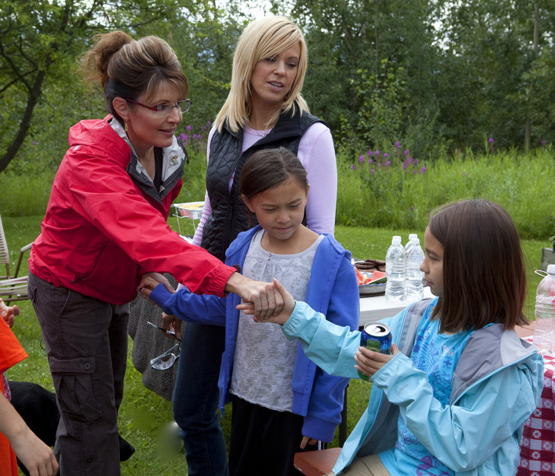 """Former Alaska Gov. Sarah Palin, left, meets twins, Cara, right, and Mady, and their mother, Kate Gosselin, as the families go camping in Coffee Creek during a taping of """"Sarah Palin's Alaska"""" in July."""