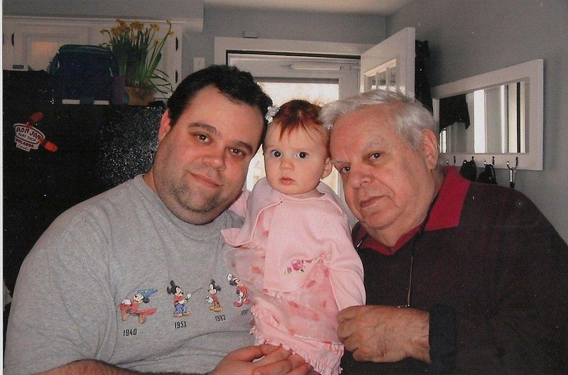 Jack Rosen, right, poses in April 2004 with his son David and granddaughter Shaylee at his son's home in Westbrook.