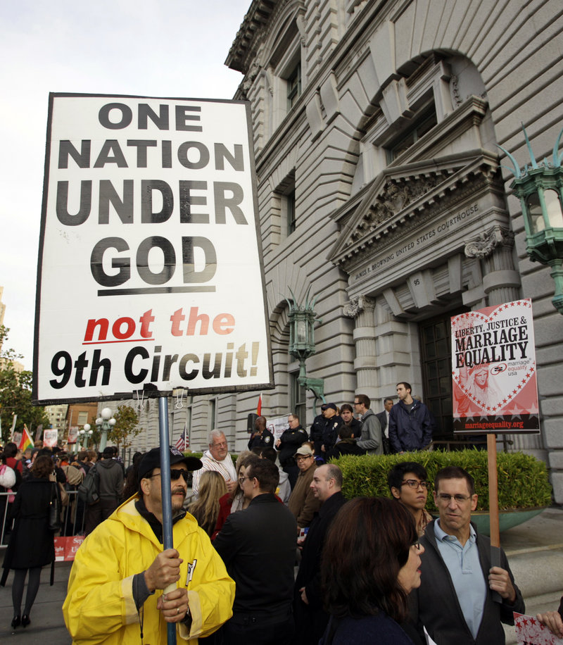 Steve Harris carries a protest sign Monday before a hearing on gay marriage at the Ninth Circuit Court of Appeals in San Francisco. The federal court is considering a trial judge's decision to overturn the voter-approved ban known as Proposition 8.