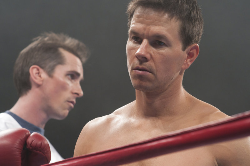 "Christian Bale, left, and Mark Wahlberg play half brothers bound by their lives in the ring in ""The Fighter."""