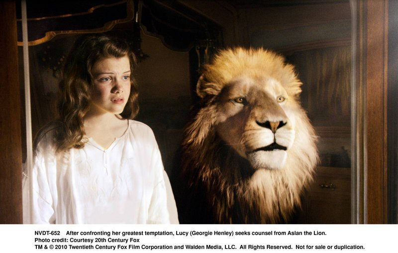 Lucy (Georgie Henley) with Aslan the Lion.
