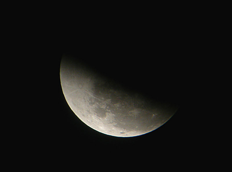The full moon reappears from the shadow of the Earth as a lunar eclipse progresses on Nov. 8, 2003. The next eclipse of the moon visible from Maine will occur on Dec. 21, and the Southworth Planetarium in Portland will play host to a viewing event.