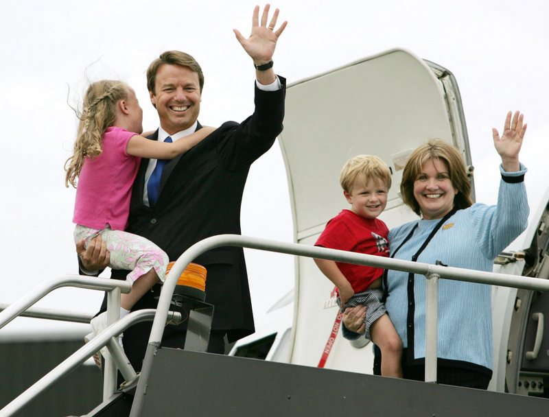 Elizabeth Edwards holds her son Jack as her husband, John, then a Democratic senator from North Carolina, carries their daughter Emma Claire while they depart the campaign plane in Boston in July 2004. Besides advising her husband on political strategy and writing two memoirs, Edwards also was an advocate for health care reform and for the poor.