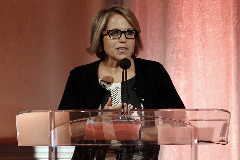 TV news anchor Katie Couric speaks at the Hollywood Reporters annual breakfast to honor powerful women.
