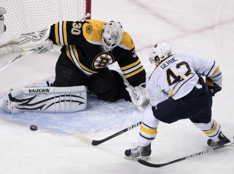 Bruins goalie Tim Thomas makes a pad save on a shot by former Portland Pirate Nathan Gerbe of the Sabres Tuesday night during Boston's 3-2 overtime victory. The winning goal came with the Bruins on a power play.