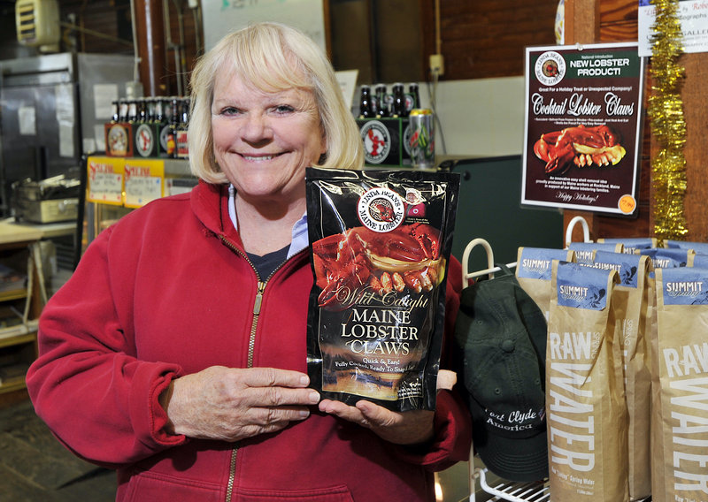 Linda Bean, granddaughter of L.L. Bean, displays a bag of her company's frozen cooked lobster claws at the Port Clyde General Store. The claws, which sell there for $7.99 a pound, will be available at Walmart stores under the terms of a deal announced last month.
