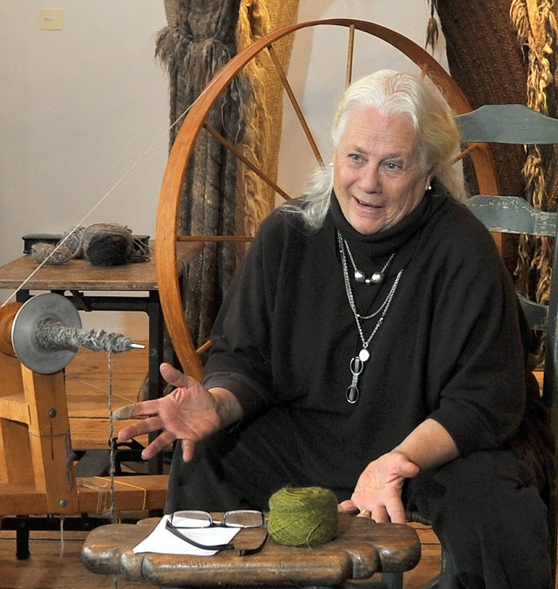 Katharine Cobey chats with a visitor at her studio in Cushing.