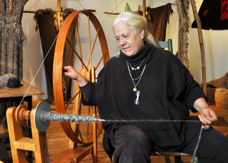 Katharine Cobey spins yarn the old-fashioned way in her Cushing studio.