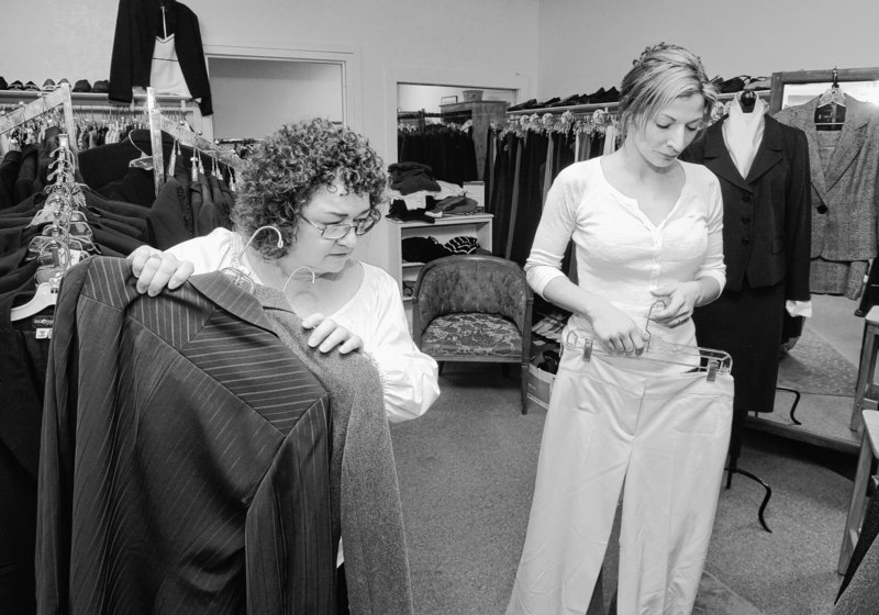 Sharon Orlando, left, assists Jillian Veilleux at Dress for Success in Portland last month. The nonprofit boutique outfits women who need proper business clothes to wear for job interviews but can't afford them.