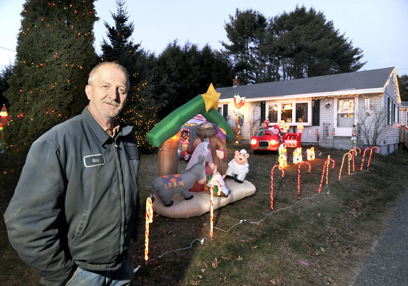 Ray Benner shows off his collection of inflatable holiday decorations at his home on Austin Street in Westbrook.