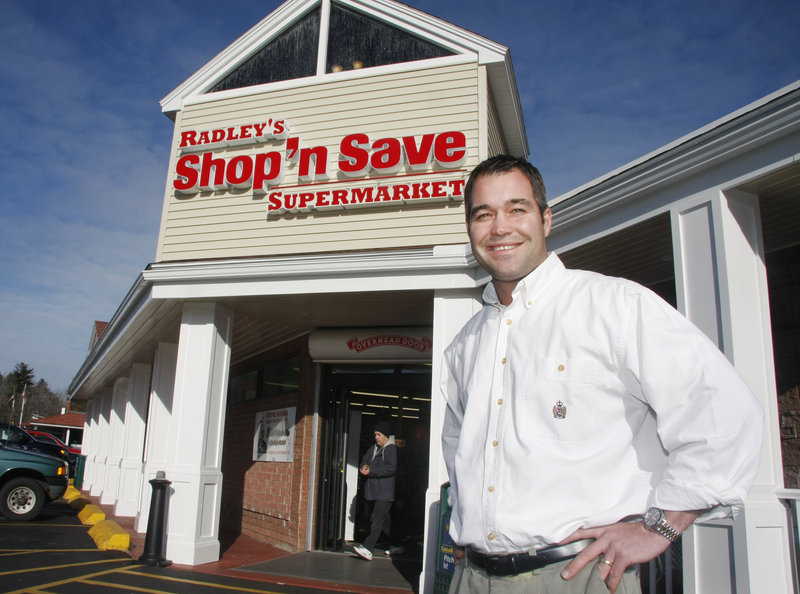 Ed Radley shows off the new storefront of Radley's Shop 'n Save Supermarket in Old Orchard Beach on Thursday. The store opened Sunday as Hannaford's newest independent retailer.