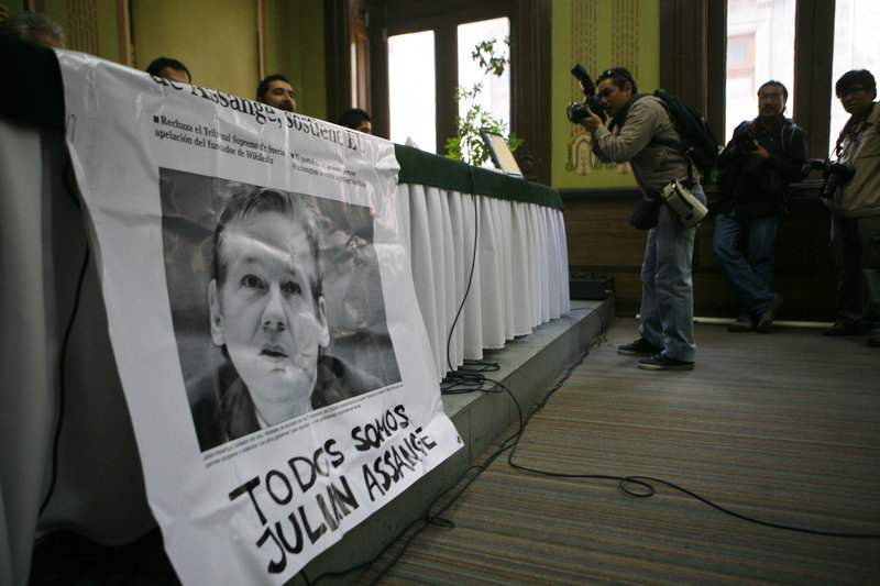 """A press conference in Mexico City features a banner with an image of Wikileaks founder Julian Assange, with Spanish text that reads: """"We are all Julian Assange."""" Human rights activists, lawmakers and writers participated in a ceremony Thursday to unveil a plaque honoring Assange at the Club of Journalists."""