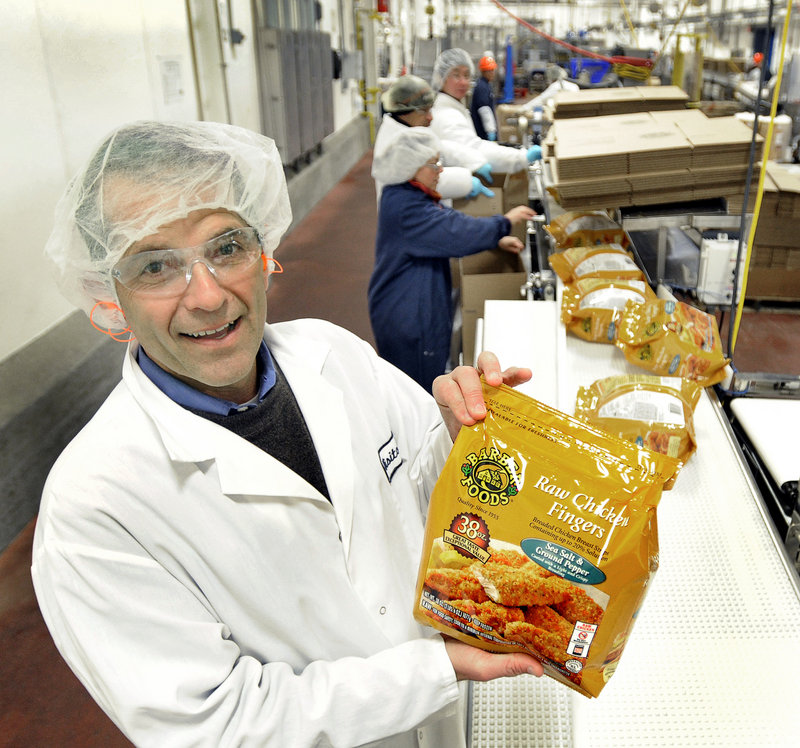David Barber, executive vice president of Barber Foods, holds a bag of chicken fingers at the Portland plant.