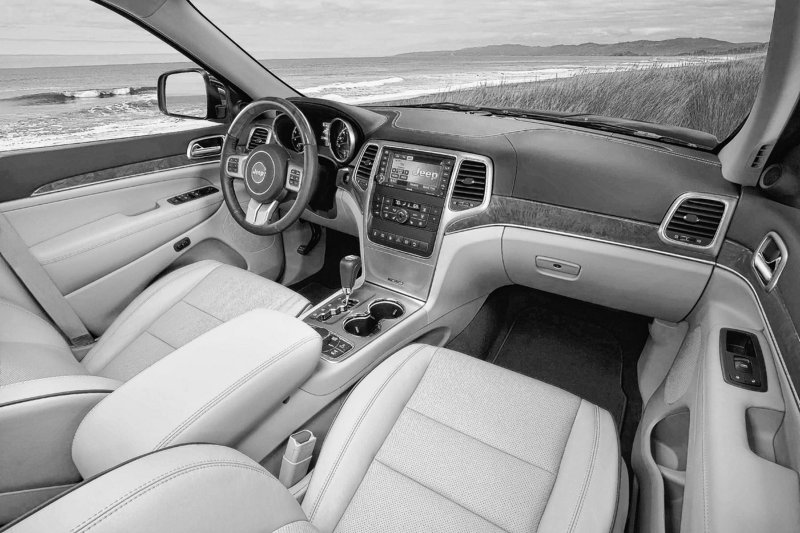 The interior of the new Jeep Grand Cherokee is quiet enough to allow a comfortable conversation between the front and back seat ... at 85 m.p.h.