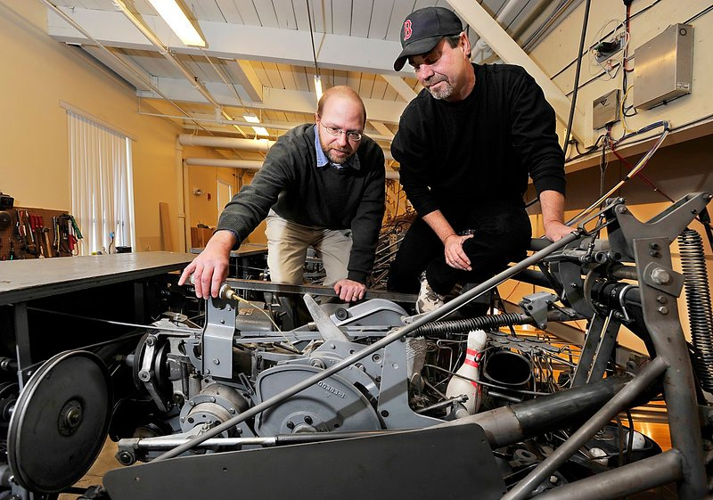 Reporter Ray Routhier oils a pin setter with Steve Closuit, operations manager and chief mechanic at Bayside Bowl, 58 Alder St. in Portland.
