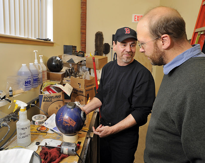 Reporter Ray Routhier learns about plugging a bowling ball with epoxy and drilling new holes for a new grip from Steve Closuit at Bayside Bowl in Portland.