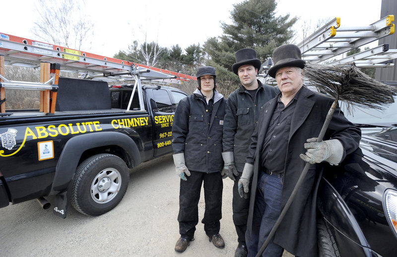 Zandy Talmage, right, and his sons Max, left, and Eben operate Absolute Chimney Service in Kennebunkport. The master sweep on any given day wears a top hat and topcoat like the chimney sweeps in old England did.