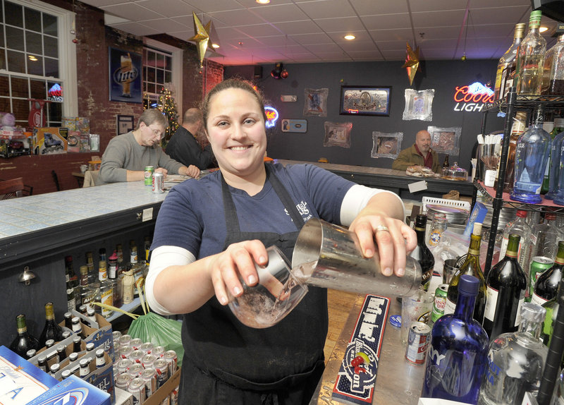 Bartender Jenn Larochelle mixes drinks at the Union House Pub & Pizza, which started as a coffee shop but changed its niche when the owners realized how popular the place was during lunch and after work.