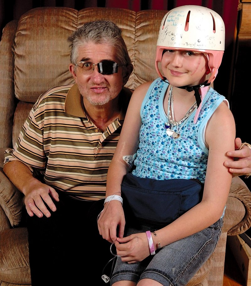 Nicole Guerrette is shown with her father, William Guerrette Jr., after they were released from the hospital in July 2008 following an attack at their Pittston home. Both suffered serious injuries.