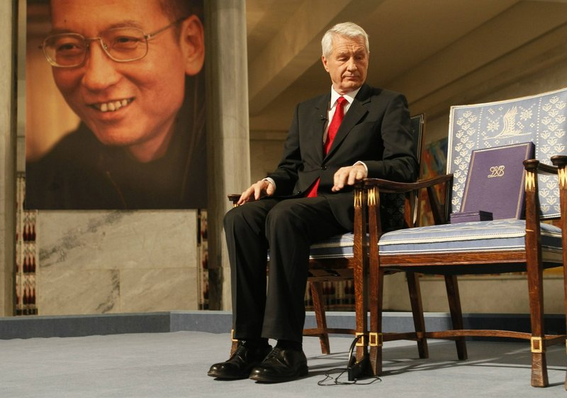 Thorbjoern Jagland, chairman of the Nobel Committee, sits next to the diploma and medal on an empty chair that symbolizes the imprisonment of peace-prize winner and activist Liu Xiaobo during a ceremony in Oslo on Friday.