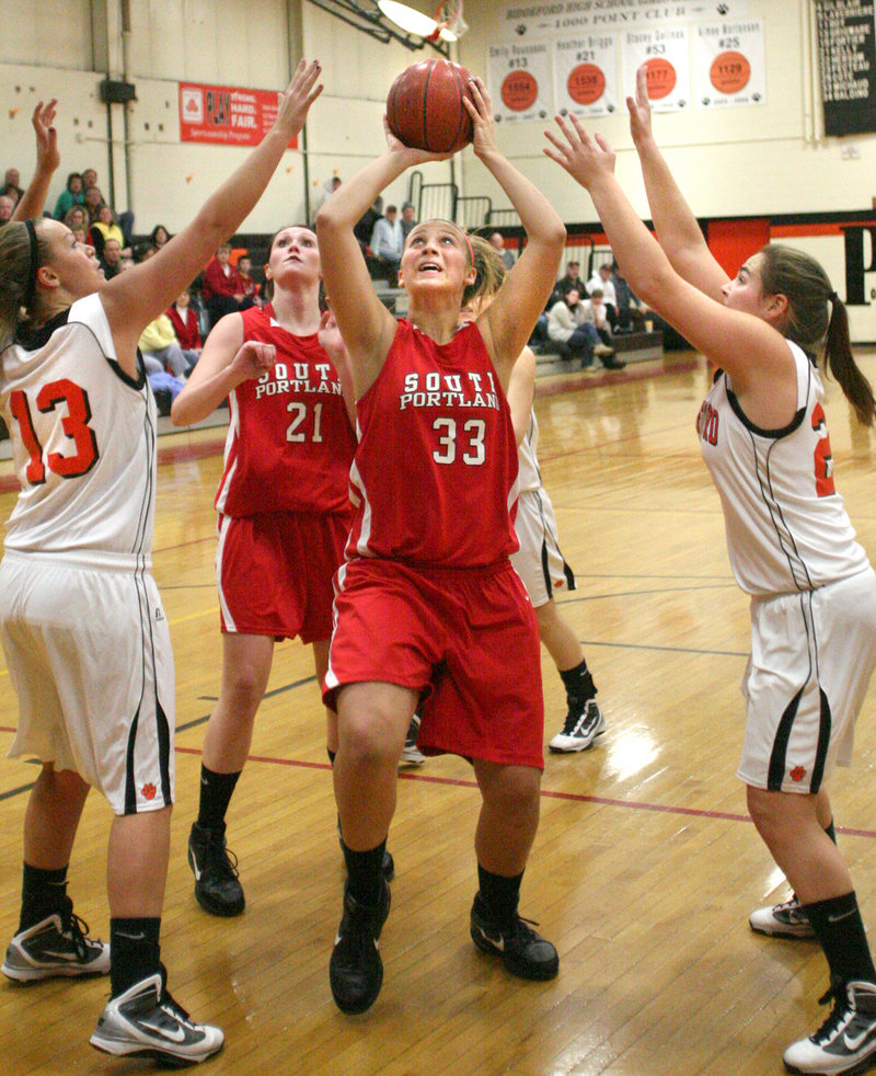 Abby Hasson of South Portland eyes the basket as she goes up for a shot Friday night against Biddeford. Hasson had 19 points to lead the Red Riots past Biddeford, 72-55.