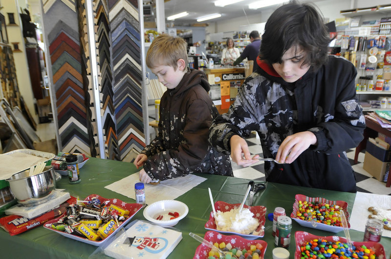 Hunter Maggs, 9, and his brother Coulton Maggs, 12, of Hollis have a number of sweet decorations to adorn the gingerbread men they're making at Sam's Place in Saco.