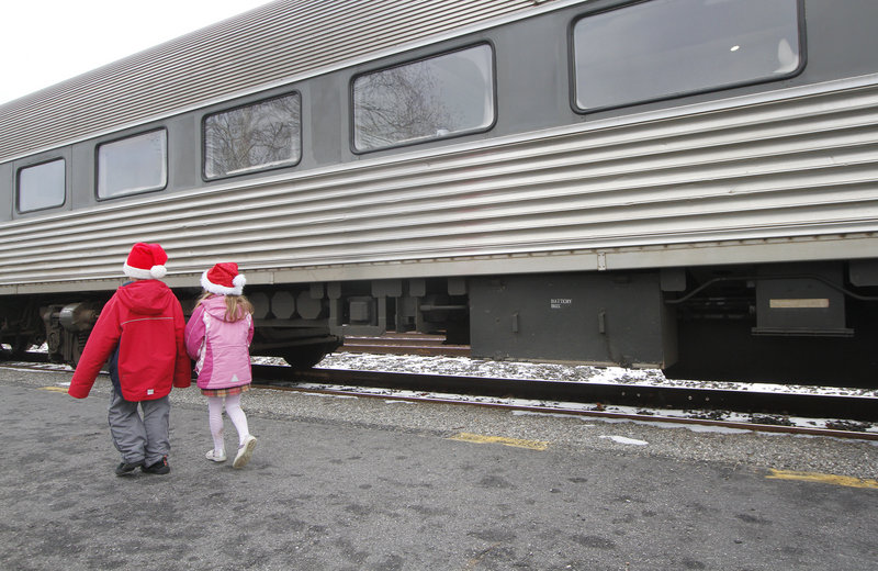 Seth Dixon of Falmouth and Grace McNally of North Yarmouth, both 6, head for the train.