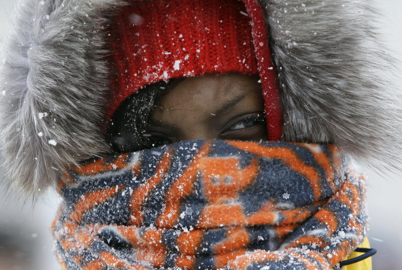 Chicago Bears fan Janise Ford arrives bundled up at Chicago's Soldier Field before the Bears and New England Patriots played a blustery game there on Sunday.