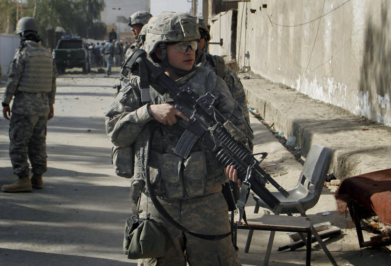 A U.S. soldier patrols Saturday in Kandahar, Afghanistan. In Sunday's attack, a suicide bomber drove a minibus into the entrance of a coalition base in Kandahar's Zari district.