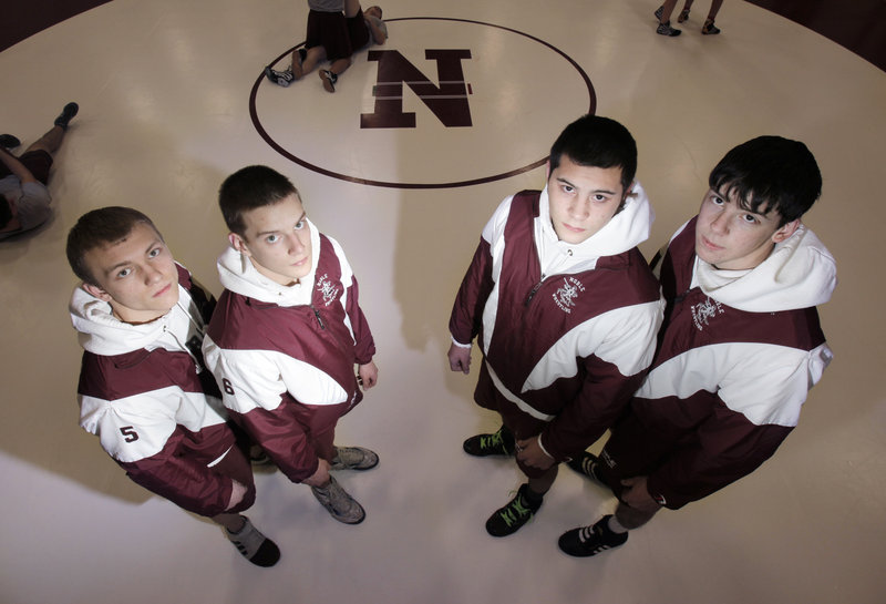 Gregory Rec/Staff Photographer Reigning state champion wrestlers returning for Noble High this year are, from left, Jake Bagley, Tyler Beaudet, Ben Valencia and Joey Badger. Valencia acknowledges the program's history inspires him.