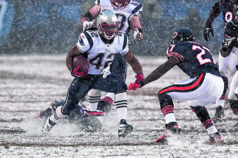 New England Patriots running back BenJarvus Green-Ellis runs against the Chicago Bears in the first half Sunday. Green-Ellis, who became the primary running back in the third game of the season, has rushed for 11 touchdowns.