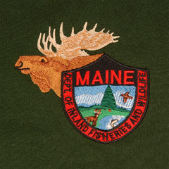 Wildlife T-shirts in warden green come embroidered with the Maine Department of Inland Fisheries and Wildlife insignia.