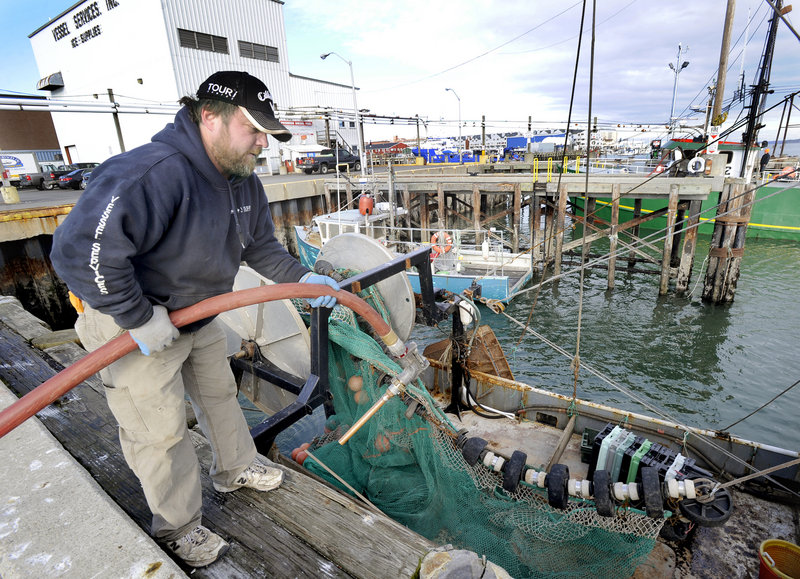 Capt. Dana Hammond fuels his dragger the Nicole Leigh on Tuesday at Vessel Services on the Portland Fish Pier.