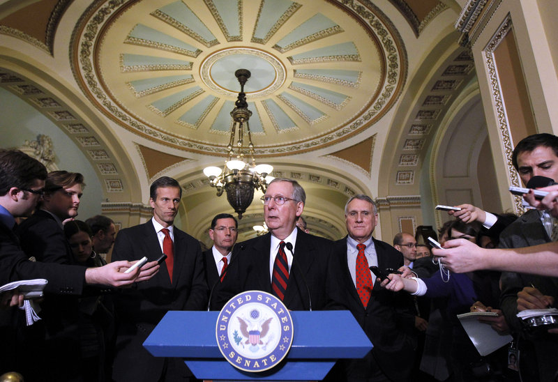 Senate Minority Leader Mitch McConnell, R-Ky., talks with reporters on Capitol Hill Tuesday about the bill that would extend the Bush tax cuts. Seen with McConnell are Sen. John Barrasso, R-Wyo., left, and Sen. Jon Kyl, R-Ariz., right.