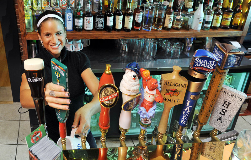 Jehna Flint pulls a draught of the seasonal special, Prelude from Shipyard, at Siano's Old Port on Fore Street. Plenty of variety at the bar and plenty of specials keep regular customers coming back.