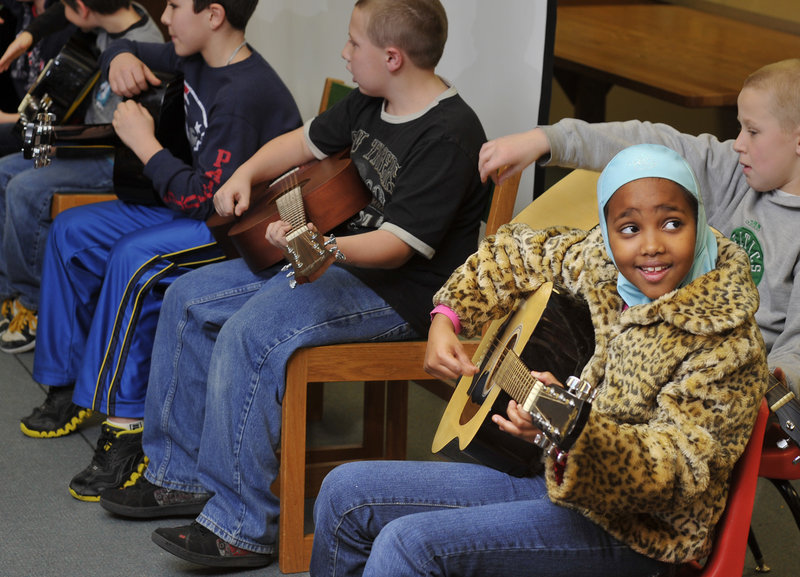 Fourth-grader Nimco Aden, 9, plays with the guitar club.