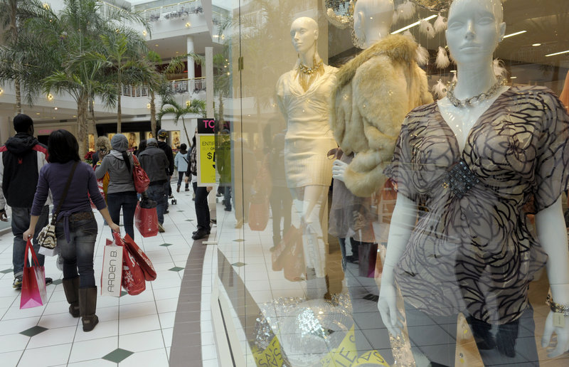 Shoppers on the lookout for sales cruise the Pentagon City Mall in Arlington, Va. Shoppers shouldn't expect 80 percent discounts this year as they finish up their holiday buying.