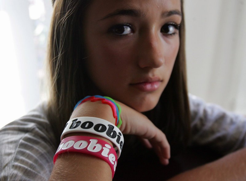 "Eighth-grader Taylor Trujillo wears the ""boobies"" bracelets that she was forced to remove at Granite Ridge Intermediate School in Fresno, Calif., earlier this year. Trujillo is one of several students across the country who have been disciplined for wearing the bracelets."
