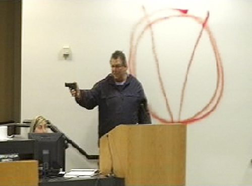 One line for cutline goes to book asjfl;kjasdlk fjasd In this image taken from video and released by WJHG-TV, Clay A. Duke points a hand gun at Bay City school board members and staff, Tuesday, Dec. 14, 2010. Duke, a 56-year-old ex-convict, calmly held the school board at gunpoint and said he was seeking redress for his wife's firing before shooting at the superintendent at short range and then killing himself. (AP Photo/WJHG-TV) MANDATORY CREDITThe Associated Press