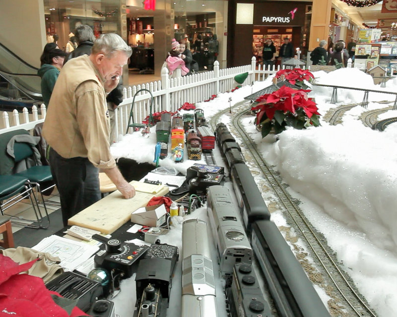Carl Churchill of Buxton runs trains at the Maine Mall. In the summer, Churchill and his wife, Patricia, regularly invite veterans' home residents to view their backyard train setup.